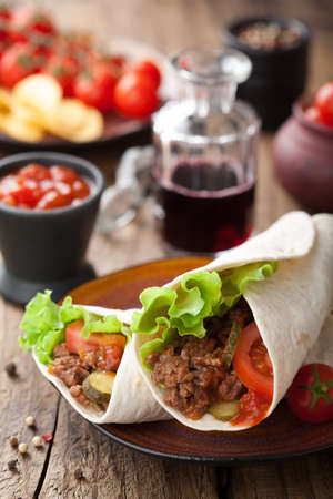 restaurant food: tortilla wraps with meat and vegetables