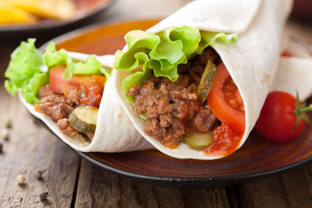 wrap: tortilla wraps with meat and vegetables