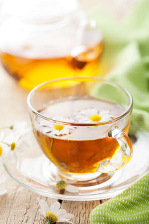 tannin: cup of herbal tea with camomile flowers