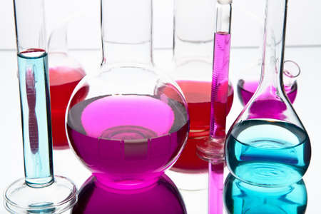 reagents: laboratory glassware with colorful chemicals