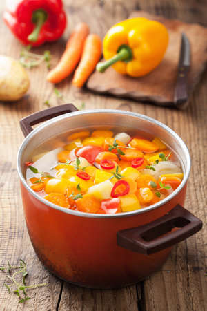 vegetable soup in red pot  Stockfoto