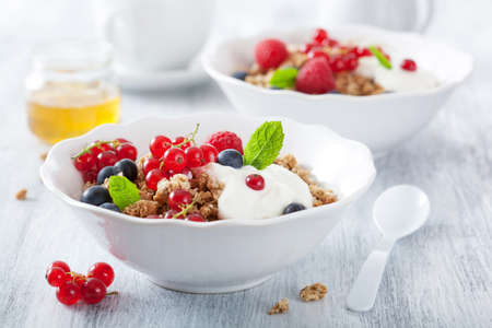 healthy breakfast with yogurt and granola  photo
