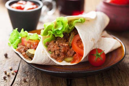 tortilla: tortilla wraps with meat and vegetables  Stock Photo