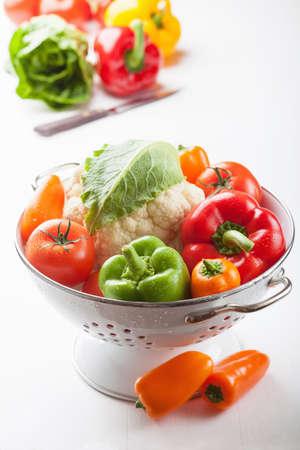 a colander: colorful vegetables in colander