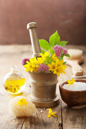 mortar and pestle medicine: mortar with flowers and herbs for spa