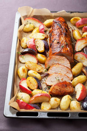 pork baked with vegetables on a tray Stock Photo - 22915936