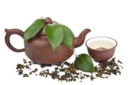 tannin: green tea in cup and pot isolated