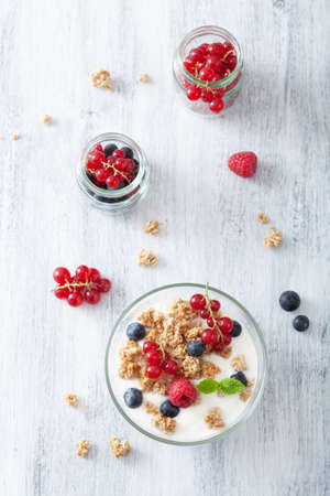 healthy breakfast with yogurt and granola  photo