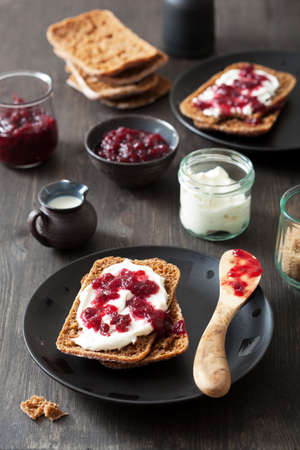 bread with creme fraiche and lingonberry jam photo
