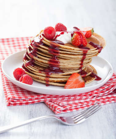 pancakes with berry and jam photo