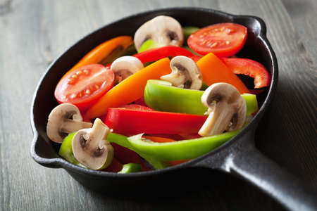 colorful vegetables in black pan ready for frying Stock Photo - 24101692