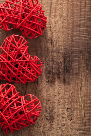 red hearts over wooden background for Valentines day photo