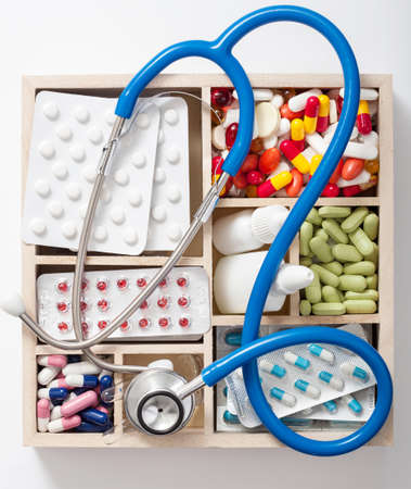 medical pills stethoscope ampules in wooden box photo