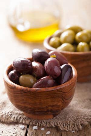 kalamata: black and green marinated olives in bowl