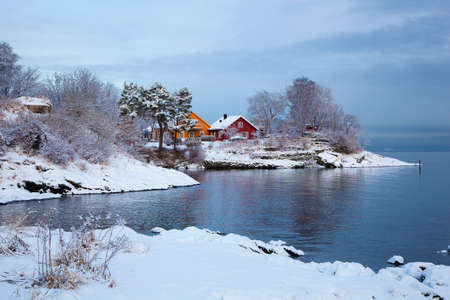 scandinavian landscape: Norwegian winter fjord landscape with colorful houses Stock Photo