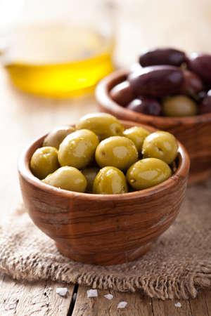 kalamata: black and green marinated olives in bowl  Stock Photo