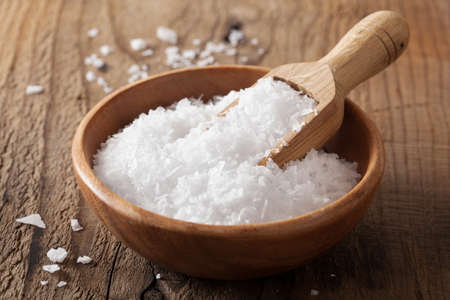 sea salt in wooden bowl and scoop  Stockfoto