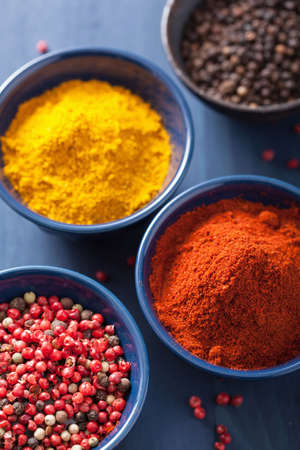 curry powder: spices in bowls: curry pink and black pepper paprika powder