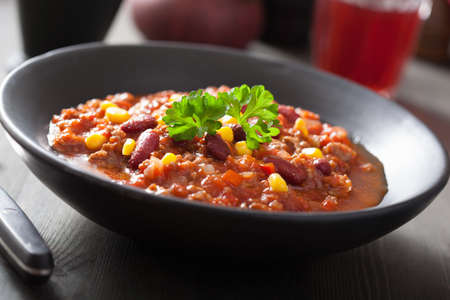 rustic food: mexican chili con carne in black plate