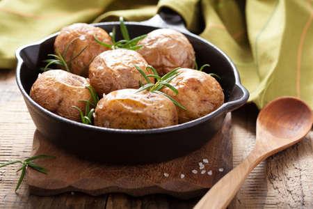 jacket potato: baked potatoes in black pan