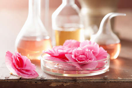 perfume oil: aromatherapy and alchemy with pink flowers