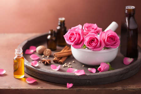 wooden aromatherapy: spa and aromatherapy set with rose flowers mortar and spices  Stock Photo