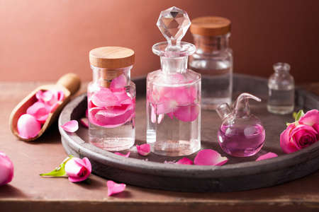 fragrance: alchemy and aromatherapy set with rose flowers and flasks  Stock Photo