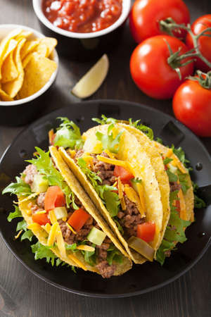 taco: mexican taco shells with beef and vegetables