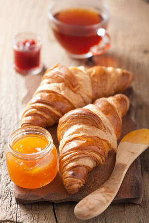 fresh croissants with jam for breakfast photo