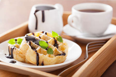 chocolate mint: Belgian waffles with chocolate and powder sugar for breakfast
