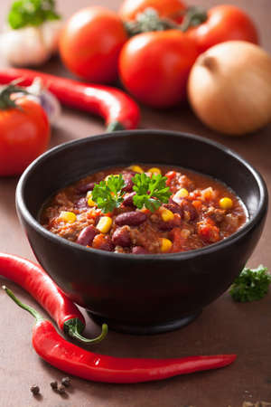 tex: mexican chili con carne in black bowl with ingredients  Stock Photo