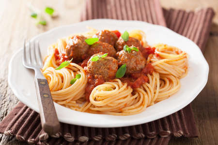meat dish: spaghetti with meatballs in tomato sauce  Stock Photo