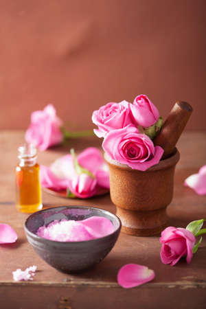 spa set with rose flowers mortar and salt  photo