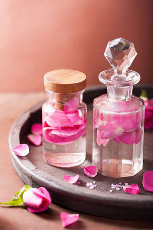 alchemy and aromatherapy set with rose flowers and flasks  Фото со стока
