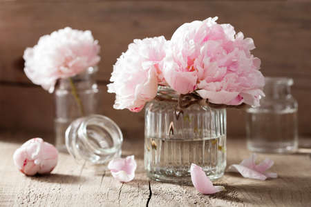 glass vase: beautiful pink peony flowers bouquet in vase