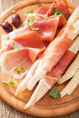 grissini: prosciutto ham and grissini bread sticks. italian antipasto  Stock Photo