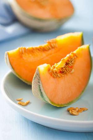 cantaloupe melon sliced on blue plate