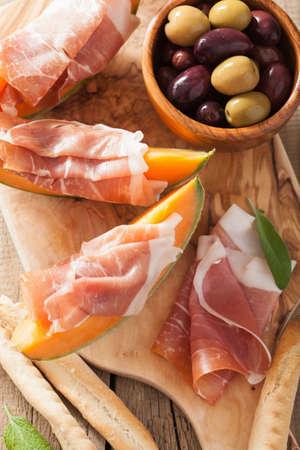 grissini: cantaloupe melon with prosciutto grissini olives. italian appetizer