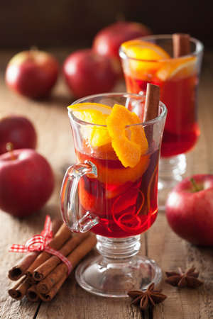 spiced: glass of mulled wine with orange and spices, christmas decoration Stock Photo