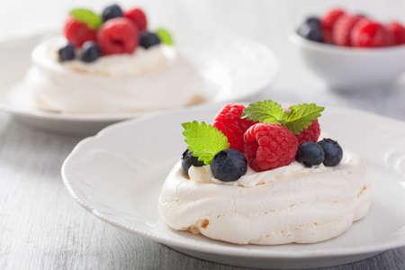 pavlova meringue cake with cream and berry photo