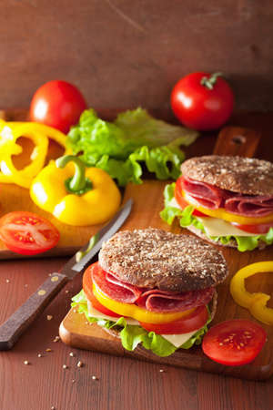 healthy sandwich with salami tomato pepper and lettuce photo
