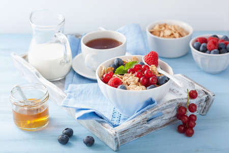 healthy breakfast with cornflakes and berry photo