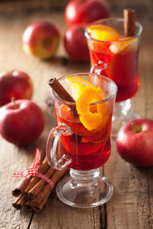 spiced: glass of mulled wine with orange and spices, winter drink