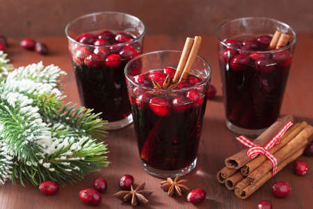 spiced: glass of mulled wine with cranberry and spices, winter drink