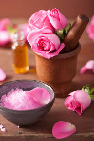 natural health: spa set with pink rose flowers mortar and herbal salt