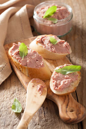 pate: healthy chicken liver pate with sage in jar and on bread