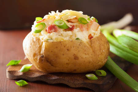 baked potato in jacket with bacon and cheese photo