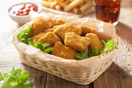 chicken salad: fast food chicken nuggets with ketchup, french fries, cola Stock Photo