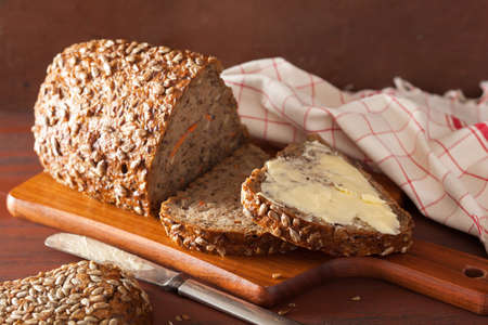 carbohydrates food: healthy whole grain bread with carrot and seeds Stock Photo