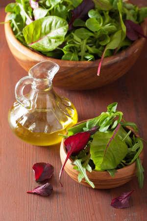 ruccola: fresh salad leaves in bowl: spinach, mangold, ruccola